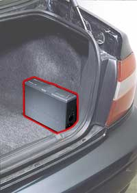 CD changer mounted on the trunk floor