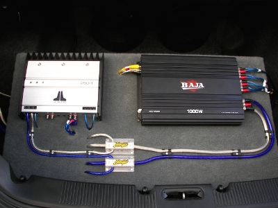 Profile & JL Audio Amplifiers Mounted on Rack in Trunk