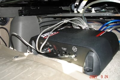 The small amp fits under the driver's seat/><p class=