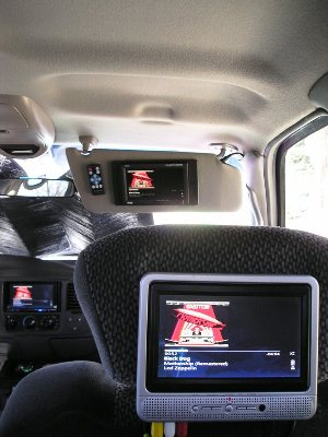 1 of two Insignia LCD Screens on headrest with a Pyle 7-inch video screen mounted to sunvisor for front passenger