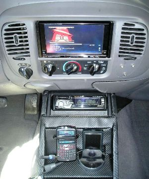 IVA-W205 with console containing the HDA-5460, Zune30 dock and phone holder