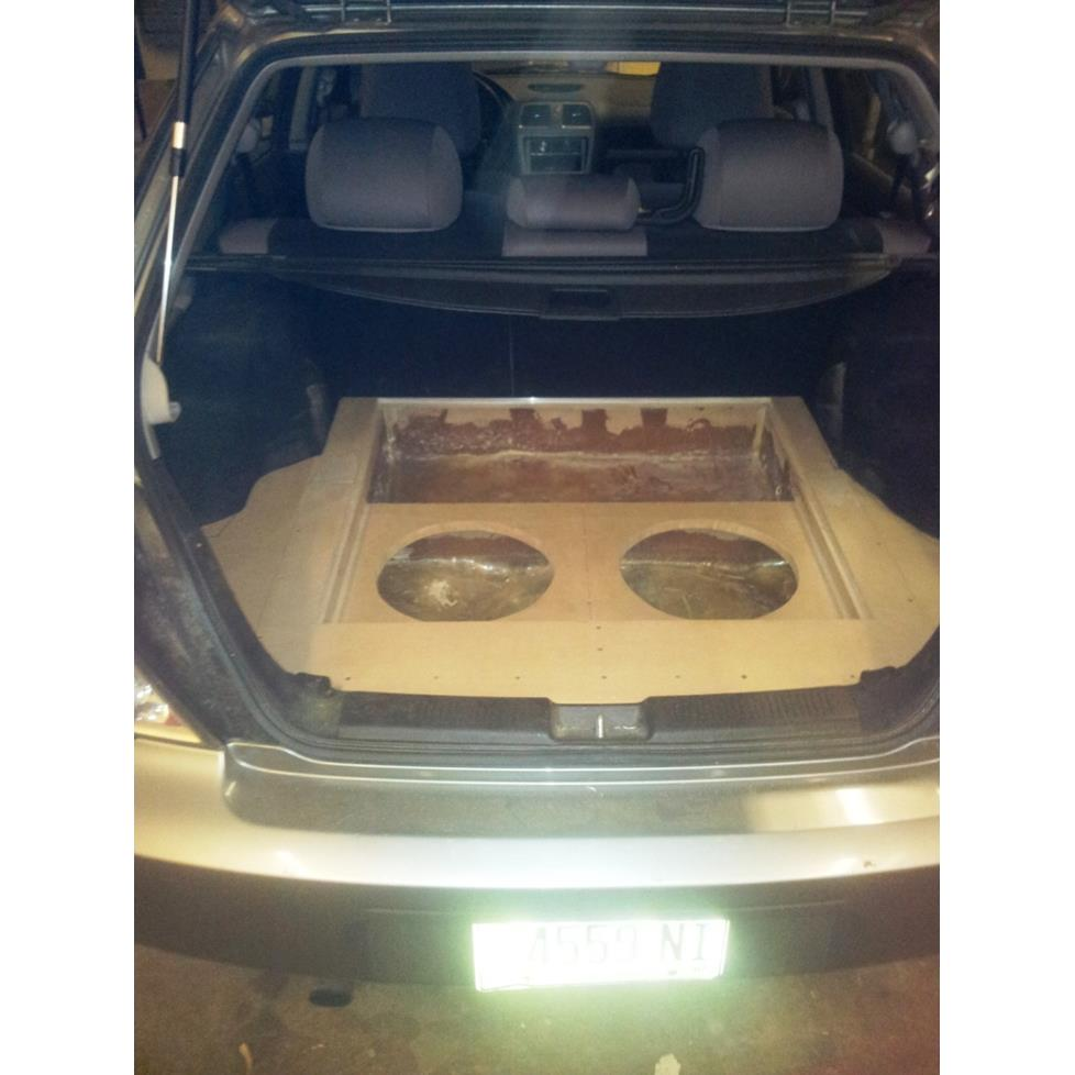 Tyler R 2007 Subaru Impreza with empty custom sub box