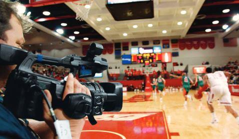Canon professional camcorder in use at a sporting event.