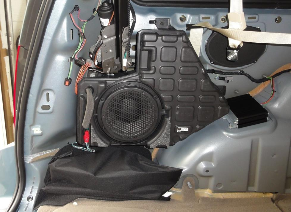 chrysler town and country factory subwoofer