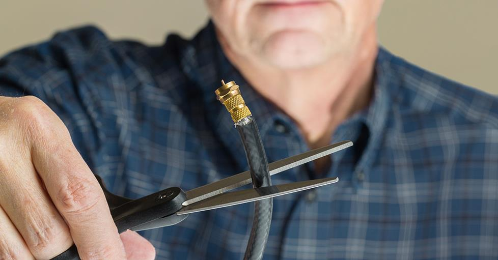 Man cutting coaxial cable