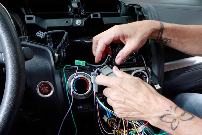 Installing A New Stereo Helps Crutchfield's Car Rese Team Ure. Alex Connects The Wiring Harness Plugs. Honda. 2015 Honda Fit Wiring Diagram At Eloancard.info