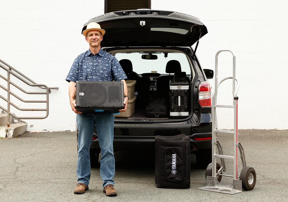 The author loading PA gear in his vehicle