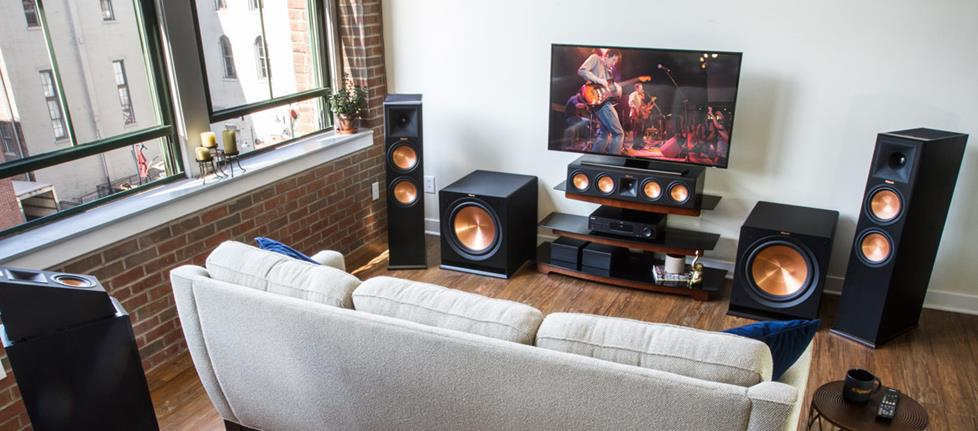 A living room home theater system with Klipsch speakers