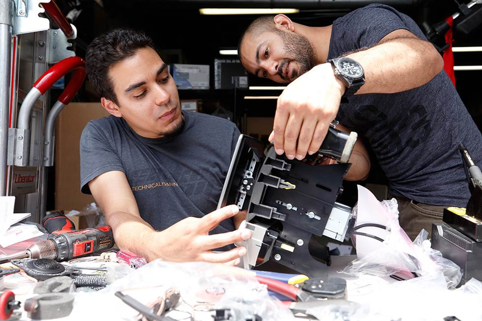 Carlos and Anthony set the angle for the Halo9 receiver's display.