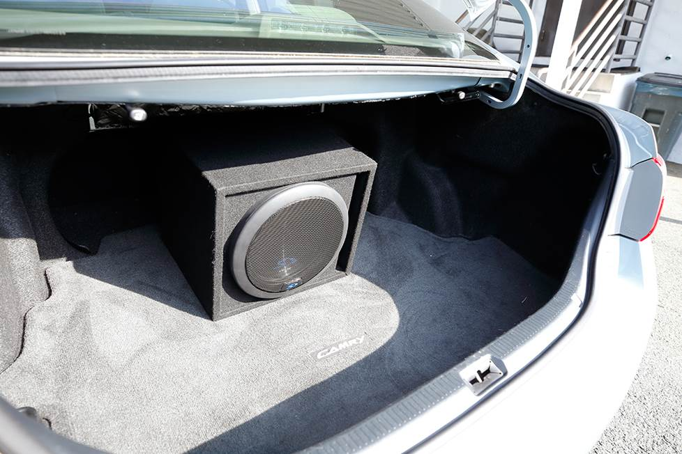 "The Alpine SWS-12D4 12"" sub in an enclosure in the trunk of a 2007 Toyota Camry."