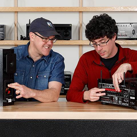 Our Advisors check out the gear so they can help you better. Here Rex and Colt get hands-on with a receiver and speakers.