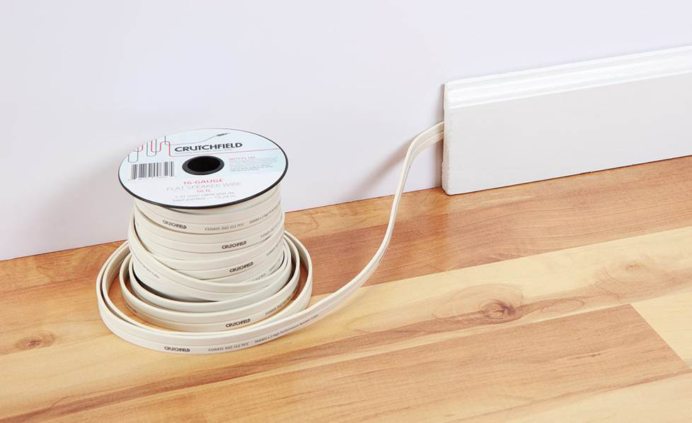 running flat speaker wire behind baseboard