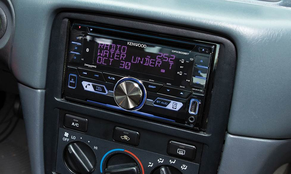 The Kenwood DPX503BT receiver mounted in the dash