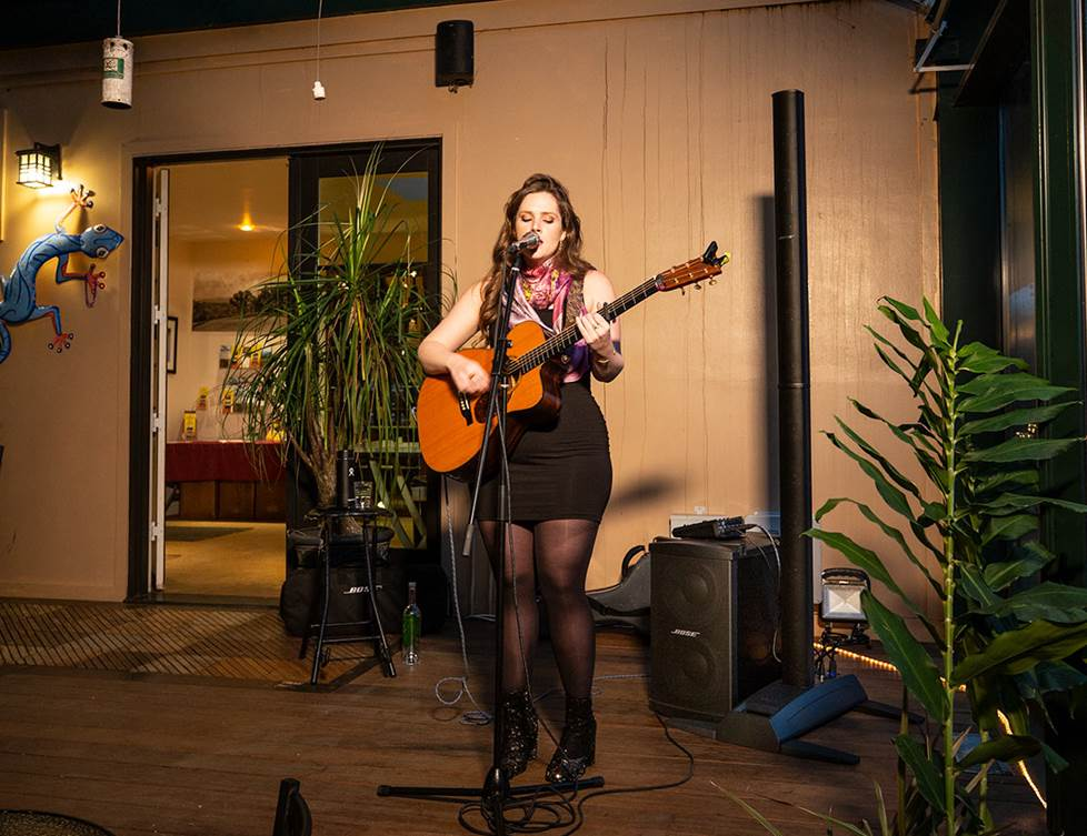 female singer-songwriter performing