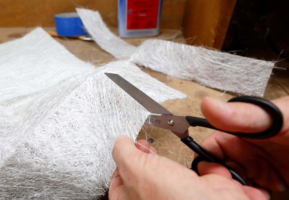 cutting fiberglass mat with scissors