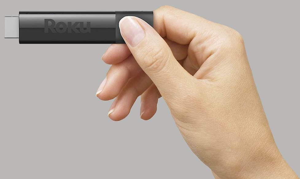 Roku streaming stick in hand