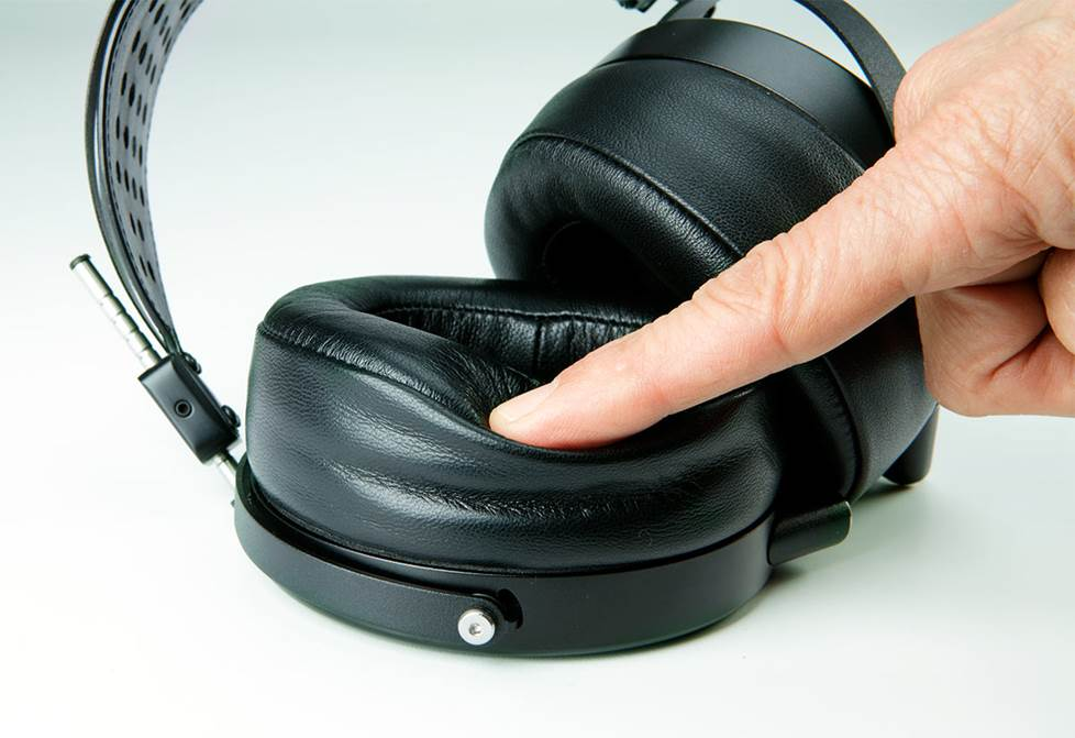 Poking the soft headphone pads