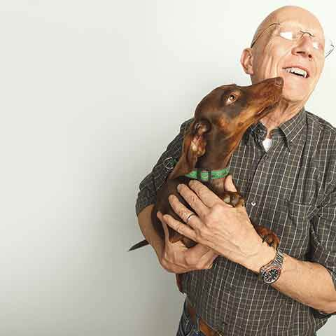 Our CEO, Bill, is a huge animal lover. His buddy Enzo smothers him with kisses during a recent photo shoot.