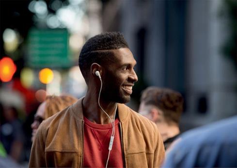 Man wearing the QC 20 headphones