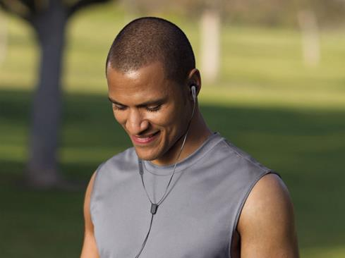 Man wearing SoundSport headphones