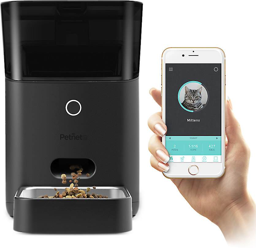 Photo of the Petnet Smart Feeder being controlled by a phone.