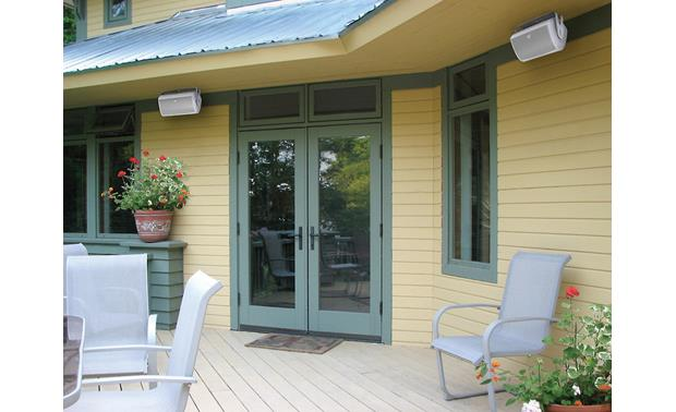 Definitive Technology AW5500 Sold individually; pair shown in white -- installed under eaves
